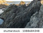 patterns over lava formed rocks ... | Shutterstock . vector #1088684348