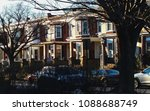 row of brick townhouses on a... | Shutterstock . vector #1088688749