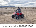man riding a quad atv bike on a ... | Shutterstock . vector #1088689046
