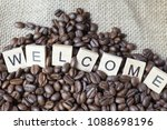 letters welcome on coffee beans. | Shutterstock . vector #1088698196