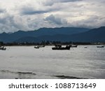 boats moored on the beach of... | Shutterstock . vector #1088713649