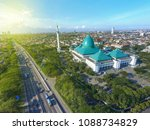 Aerial Al Akbar Mosque Surabaya, is a Located in SURABAYA INDONESIA with blue sky background