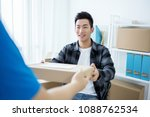 man receive delivering package | Shutterstock . vector #1088762534