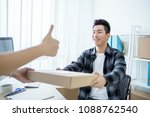 Small photo of man receive delivering package
