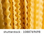 uncooked spaghetti on table | Shutterstock . vector #1088769698