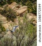 Sandstone Rocks And Tree Tops...