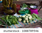 a farmer selling her produce at ... | Shutterstock . vector #1088789546