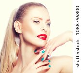 Small photo of Beauty caucasian model girl with bright make up, red lips, teth smile and perfect fresh skin hold hands with blue nail polish salon manicure near head. Blonde hair woman