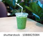 a plastic glass of iced green... | Shutterstock . vector #1088825084