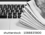newspapers and laptop. pile of... | Shutterstock . vector #1088835800