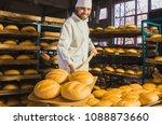 baker. a young handsome bakery... | Shutterstock . vector #1088873660