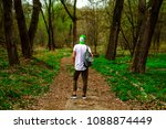 guy with backpack in the woods | Shutterstock . vector #1088874449