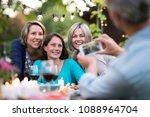 one summer evening friends... | Shutterstock . vector #1088964704
