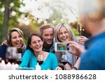 some friends in their forties... | Shutterstock . vector #1088986628