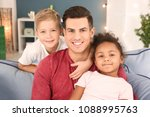 young man and little kids... | Shutterstock . vector #1088995763