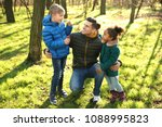 father and little kids outdoors ... | Shutterstock . vector #1088995823