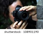 young woman with a dslr camera | Shutterstock . vector #108901190