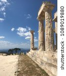 Small photo of Photo of iconic ancient Temple of Afaia in island of Aigina with views to Saronic Gulf, Greece