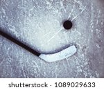 hockey puck and stick on the... | Shutterstock . vector #1089029633