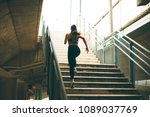 young woman running alone up...   Shutterstock . vector #1089037769
