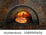 pizza near the stone stove with ... | Shutterstock . vector #1089045656