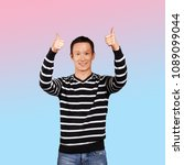 asian man in striped pullovert  ... | Shutterstock . vector #1089099044