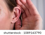 woman listening with her hand... | Shutterstock . vector #1089163790