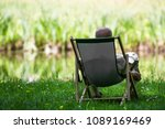 man sitting on a lounger in a... | Shutterstock . vector #1089169469