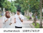 happy young asian couple... | Shutterstock . vector #1089176519