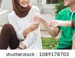 friend giving water bottle...   Shutterstock . vector #1089178703