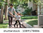 dad help his son learning to... | Shutterstock . vector #1089178886