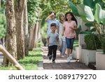 cheerful asian muslim family... | Shutterstock . vector #1089179270