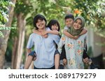 two kids with their parent... | Shutterstock . vector #1089179279