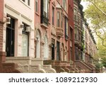 A Row Of Colorful Brownstones...