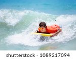 teenager boy surfing on... | Shutterstock . vector #1089217094