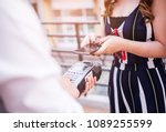 a woman's hand holding and...   Shutterstock . vector #1089255599