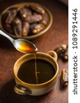 delicious date syrup in a bowl... | Shutterstock . vector #1089291446