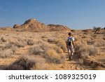 one person hiking in the namib... | Shutterstock . vector #1089325019