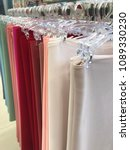 Small photo of Colorful shawl scarves folded at the market women's accessories fashion head cover veil