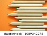 pencils on orange background. | Shutterstock . vector #1089342278