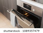 opened oven with grey towel... | Shutterstock . vector #1089357479
