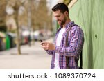 smiling young man looking his...   Shutterstock . vector #1089370724