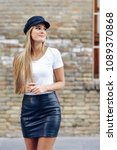 young blonde woman smiling near ...   Shutterstock . vector #1089370868