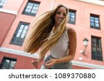 happy young woman with moving... | Shutterstock . vector #1089370880
