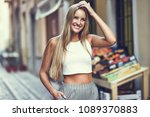 smiling young woman in urban... | Shutterstock . vector #1089370883