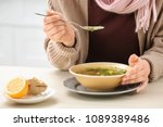 sick young woman eating broth... | Shutterstock . vector #1089389486