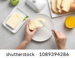 woman spreading butter on slice ... | Shutterstock . vector #1089394286
