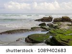 rocks and sea on the beach of... | Shutterstock . vector #1089402683