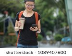 walking with coffee themo cup... | Shutterstock . vector #1089407600