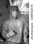 Shaded surgeon standing calmy before coming difficult surgery - stock photo